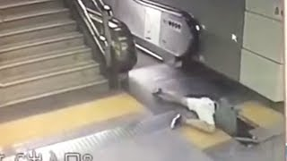 Woman fall through through broken floor tile at subway escalator