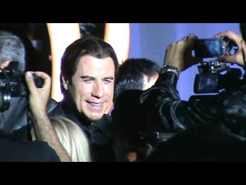 JOHN TRAVOLTA WORKS THE IIFA GREEN CARPET IN TAMPA