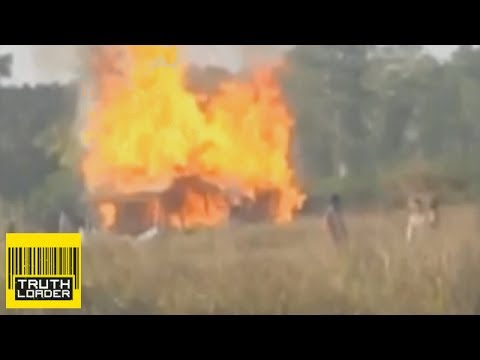 Soldiers burn down Cambodian homes for Chinese company - Truthloader