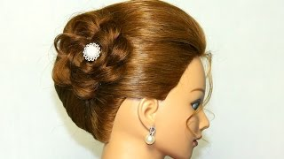 Hairstyle for medium long hair. Updo with braided flower