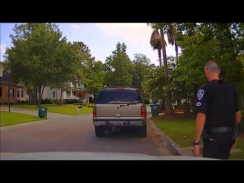 Police Officer Clings To Fleeing Vehicle