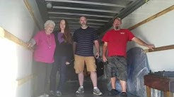 Grand piano tip  U-Haul truck with  Asheville Antique  piano movers in Franklin NC