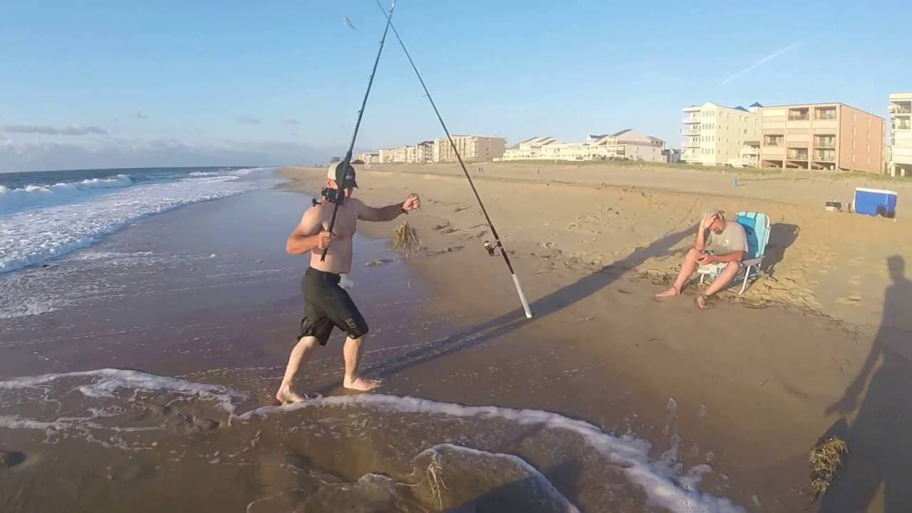 Sand tiger shark from beach ocean city maryland youtube for Surf city fishing report