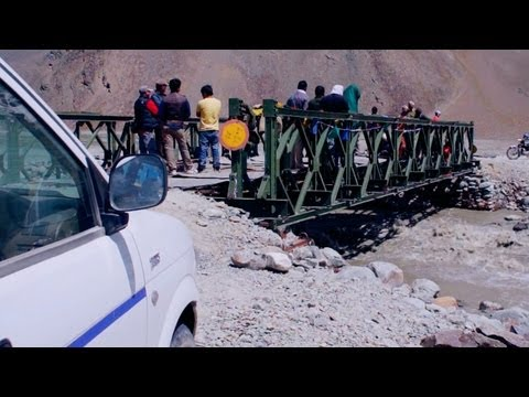 Crossing the mountain stream in Leh