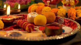 Diwali Puja - Shot of a woman preparing puja thali / plate
