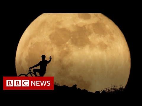 Super 'blood' Moon treats stargazers around the world - BBC News