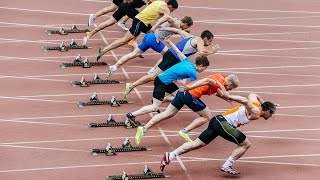 group men athletes start and run at sprint competitions at stadium