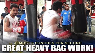 PACMANS FOOT SPEED AND HIM ALMOST WANTING TO DESTROY THE HEAVY BAG