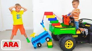فلاد ونيكيتا تلعب مع لعبة سحب الشاحنة للأطفال