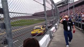 Daytona 500 Close up Along Wall an Fence.  Speed.
