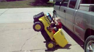 power wheels dump truck wheelie