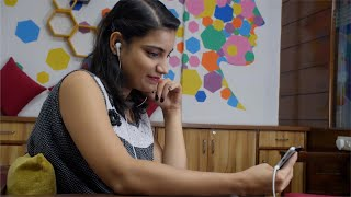 Cute Indian girl doing a video chat on her mobile smartphone with her friend