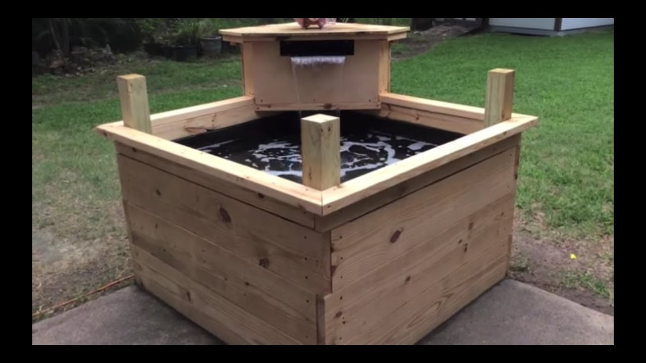 Raised wooden koi pond youtube for Wooden koi pool