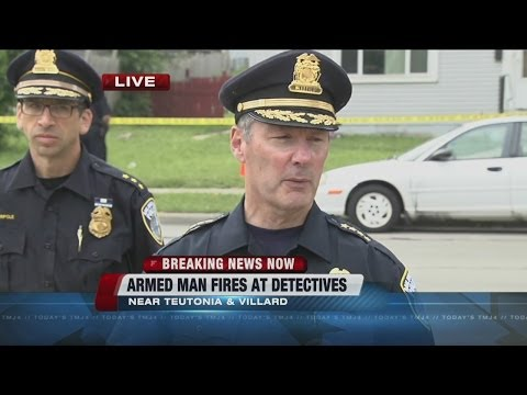 MPD detective grazed by bullet by person of interest in homicide case
