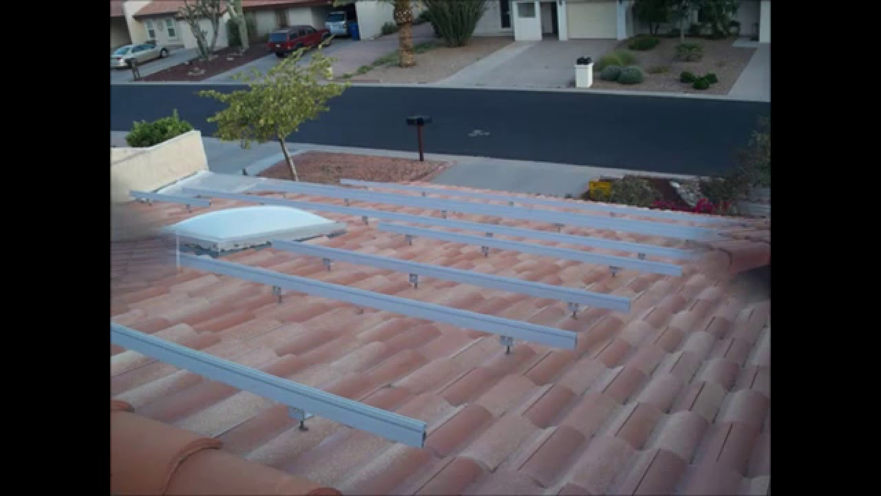 Solar panel installation on a tile roof youtube dailygadgetfo Gallery
