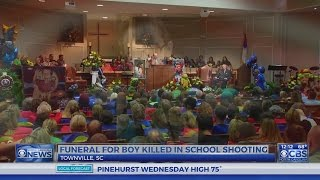 Boy killed in SC school shooting laid to rest with super hero funeral