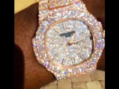 Plies flexing with his $100k watch