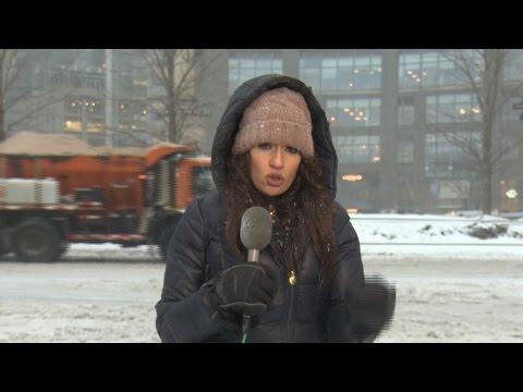 New York City shuts down as snow turns to sleet