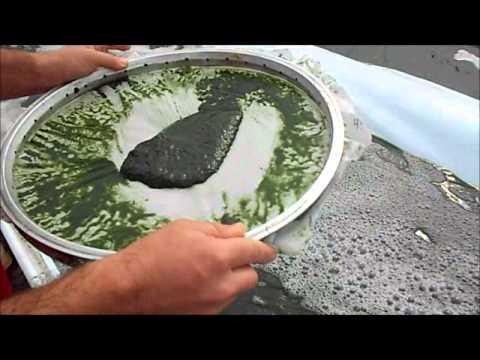 AlgaeArt   filtering Spirulina by hand