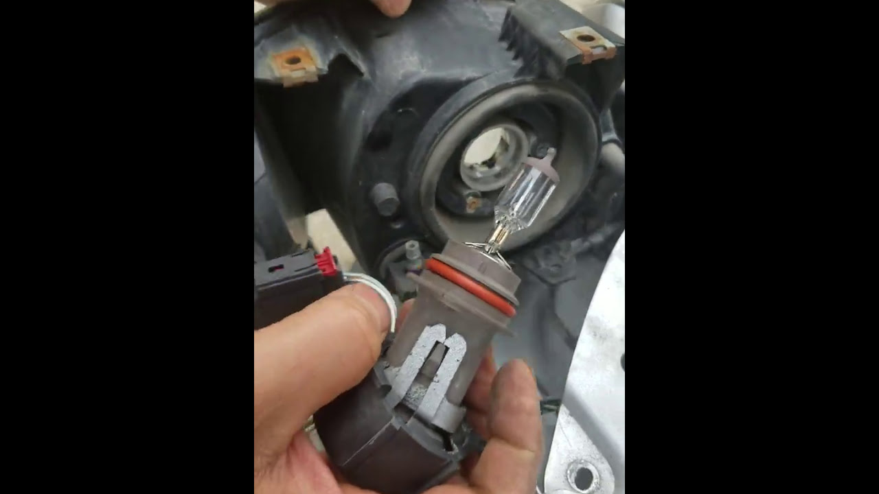 How To Install Replace Headlight And Bulb Chrysler Town Country 2004