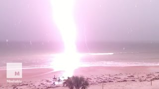 Captivating slow motion footage shows moment lightning strikes a beach | Mashable