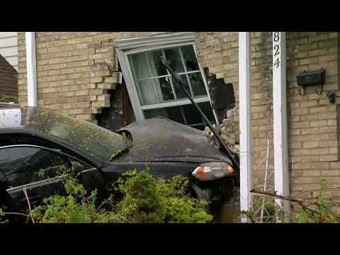 Car crashes into home on West Silver Spring Drive