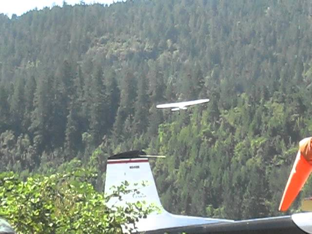 Cessna 195 departing Agness, OR