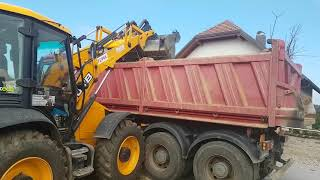 JCB 4cx backhoe loader loading a truck with dirt