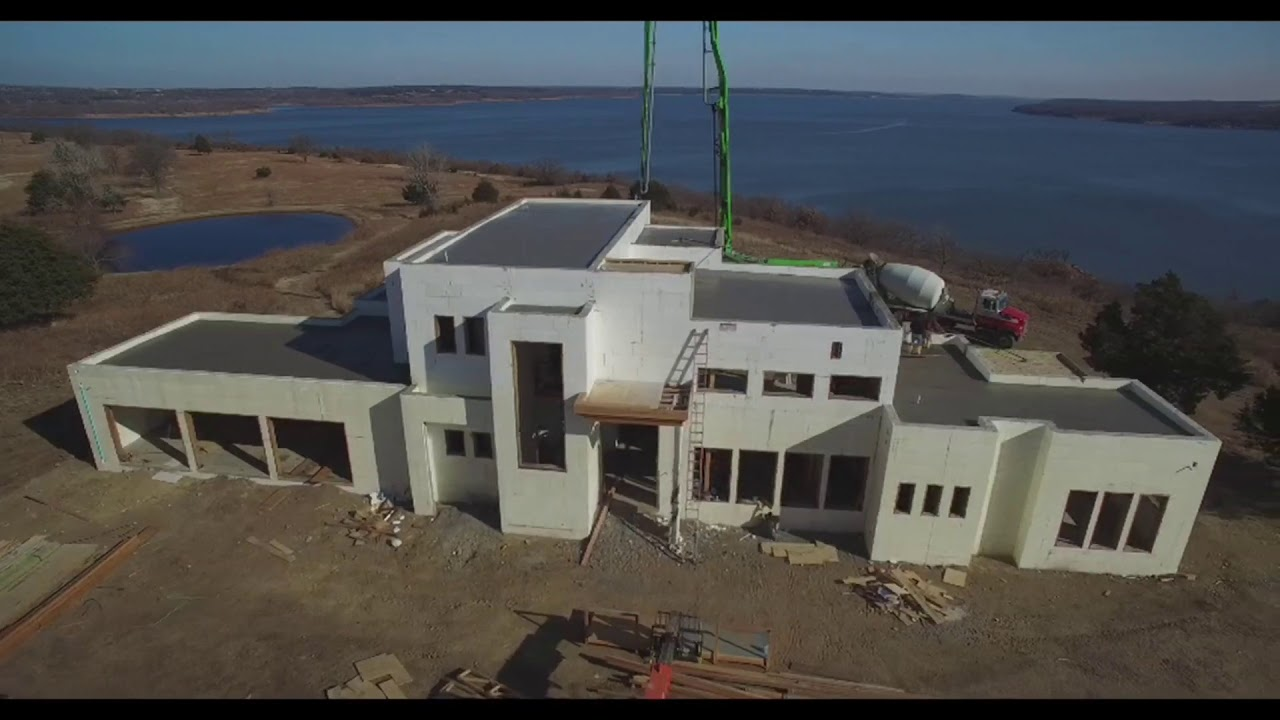 Green Machine: Contemporary ICF home with low slope roofs on sip flat roof, concrete flat roof, insulation flat roof, icf house roof, building a flat roof, icf roof design, icf roof systems,