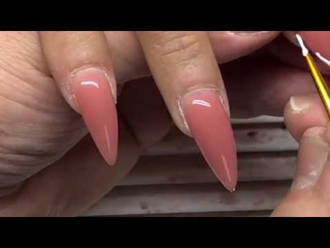 Stiletto nails beauty tutorial of gel nail extensions and french nail art designs