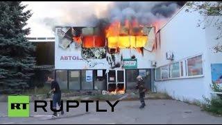 Ukraine: Lugansk garage burns after Grad shelling by Kiev forces