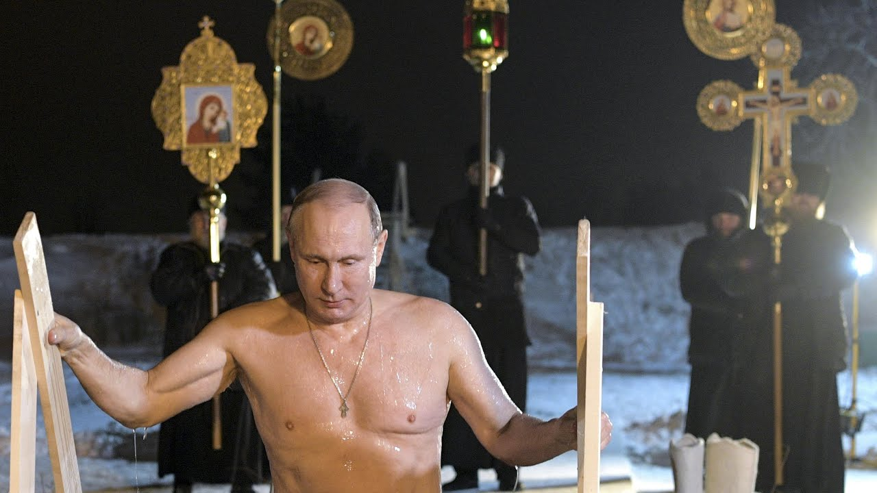 Putin Takes Icy Plunge To Mark Russian Orthodox Epiphany World News The Guardian