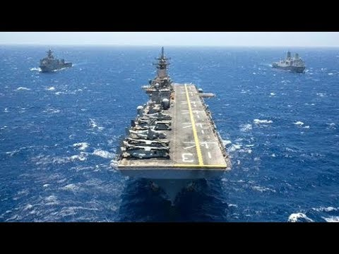 Two lranIan fast boats approached the US Wasp-class amphibious assault ship