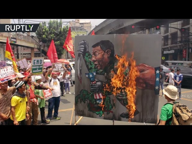 Duterte effigy up in flames as protesters march on Marawi siege anniversary