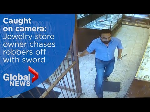 Jewelry store owner chases robbery suspects off with sword - YouTube