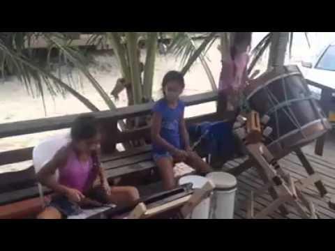Cook island girls drumming