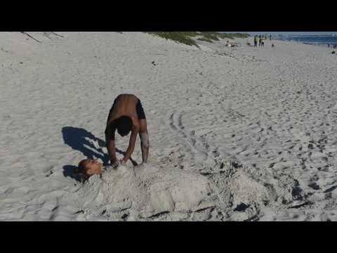 Girl Buried in Sand,  Cape Town, South Africa