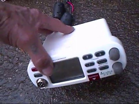 A Cobra VHF Ships Radio, and a Garmin, GPS 12, wired together for