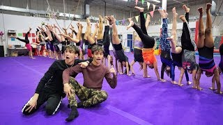 Download Who can HOLD the LONGEST HANDSTAND wins $10,000! Mp3 and Videos