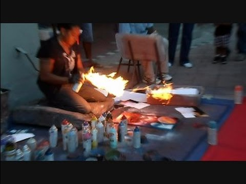 Man Makes Art With Spray Paint And Fire