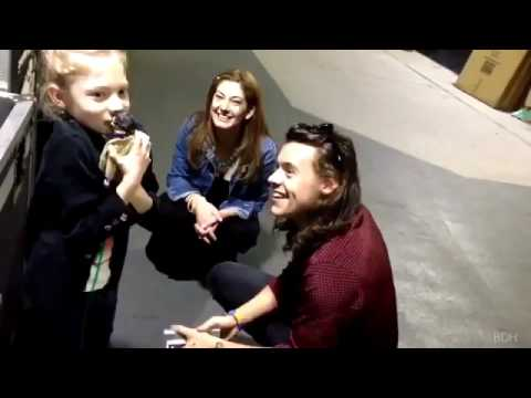 Harry Styles meeting a young fan .
