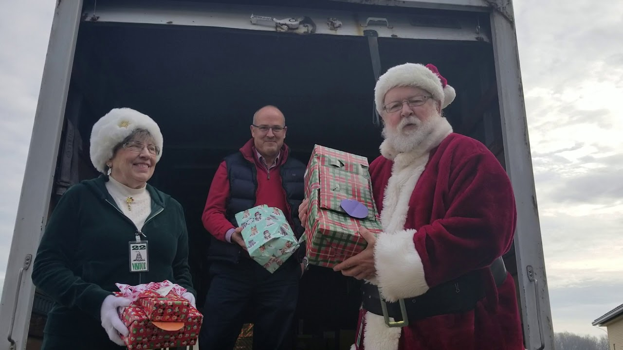 Santa Delivers Smiles & Gifts