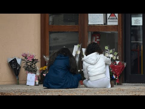 French police arrest 9 people after 18-year-old decapitates teacher in terror attack