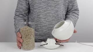 Filling the Birdball Seed Feeder