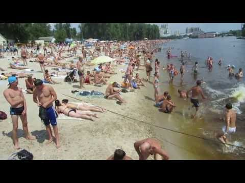 Swimming in a beach on the Dnipro River (Dnieper) in Kylv (Kiev) near hydro Park