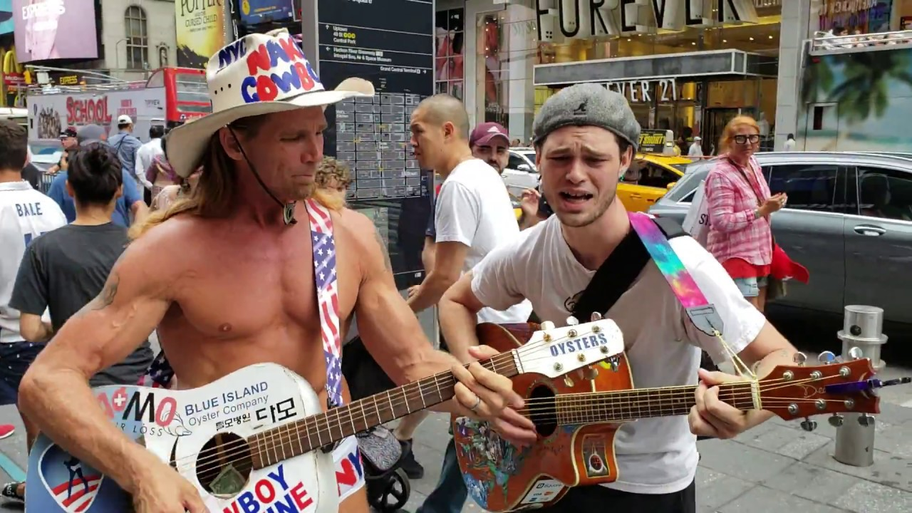 Naked Cowboy Still Singing in Times Square (With Face Mask