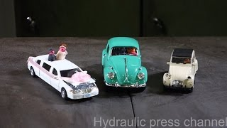 Crushing toy cars with hydraulic press