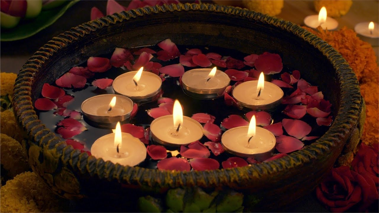 Diwali decoration - woman keeping floating candles in a bowl / urli -  Diwali Celebration Stock Video   Knot9