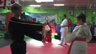 Owen testing for his green stripe belt in tae kwon do