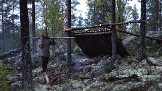 Bushcraft trip - shelter building, boat down river, reindeer skin, meat, collared axe [part 1]